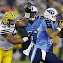 Tennessee Titans offensive tackle Taylor Lewan (77) tries to keep Green Bay Packers linebacker Nick Perry (53) away from Titans quarterback Charlie Whitehurst, right, in the second quarter of a preseason NFL football game Saturday, Aug. 9, 2014, in Nashvi