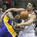 Milwaukee Bucks' Zaza Pachulia fouls Los Angeles Lakers' Jordan Hill during the second half of an NBA basketball game Thursday, March 27, 2014, in Milwaukee The Associated Press