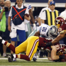 Washington Redskins linebacker Trent Murphy (93) recovers a Dallas Cowboys' Joseph Randle (21) fumble during the first half of an NFL football game, Monday, Oct. 27, 2014, in Arlington, Texas. (AP Photo/Tim Sharp)