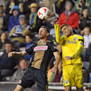 Philadelphia Union forward Sebastien Le Toux, goes up for a header against the Columbus Crew midfielder Hector Jimenez, during the first half of their MLS soccer match at PPL Park in Chester Pa., Saturday Oct. 11, 2014 The Associated Press