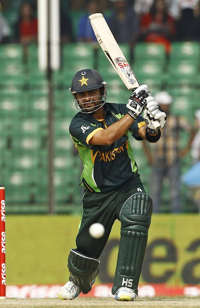 Pakistan's Ahmed Shehzad plays a shot during their match against Afghanistan in the Asia Cup one-day international cricket tournament in Fatullah, near Dhaka, Bangladesh, Thursday, Feb. 27, 2014