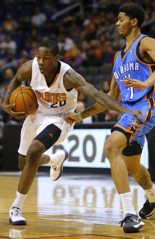 Phoenix Suns's  Archie Goodwin (20) drives past Oklahoma Thunder's Jeremy Lamb during the second half of an NBA preseason basketball game, Tuesday, Oct. 22, 2013, in Phoenix