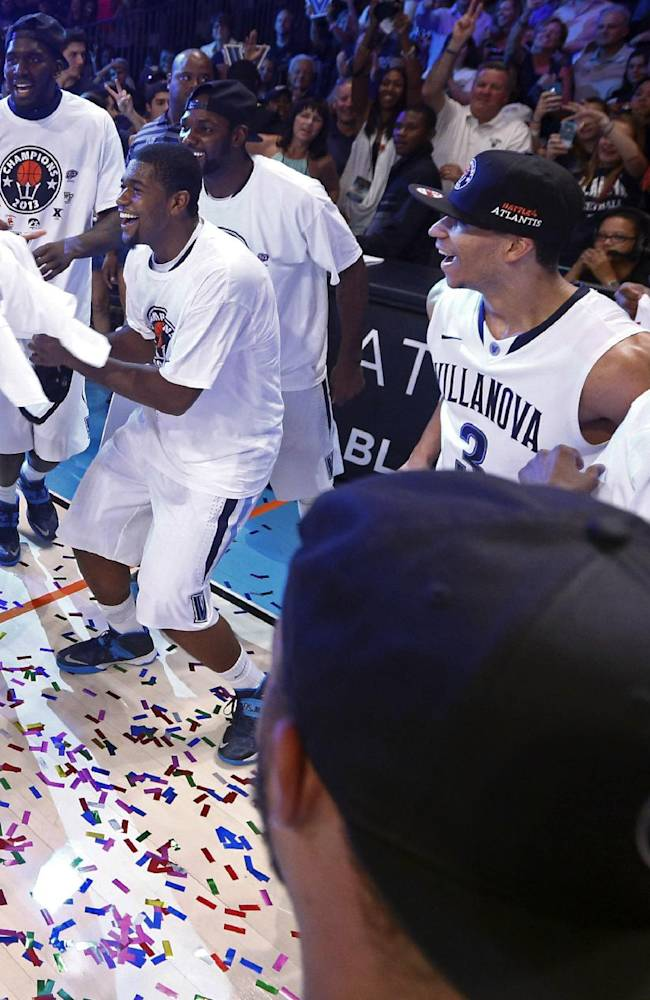 The Villanova basketball team celebrates after winning the Battle 4 Atlantis championship with an 88-83 win over Iowa in overtime in an NCAA college basketball game in Paradise Island, Bahamas, Saturday, Nov. 30, 2013