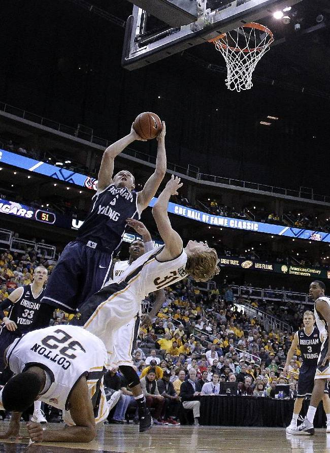 BYU's Kyle Collinsworth (5) shoots over Wichita State's Ron Baker (31) during the second half of an NCAA college basketball game Tuesday, Nov. 26, 2013, in Kansas City, Mo. Wichita State won 75-62