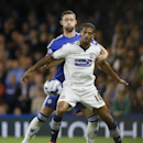 Chelsea's Gary Cahill, left, vies for the ball with Bolton's Jermaine Beckford during the English League Cup soccer match between Chelsea and Bolton Wanderers at Stamford Bridge Stadium in London, Wednesday, Sept. 24, 2014.
