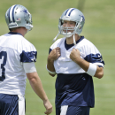 In this Tuesday, June 17, 2014, file photo, Dallas Cowboys quarterback Tony Romo, playfully covers his number after exchanging his jersey with a teammate during an NFL football minicamp in Irving, Texas. The 34-year-old quarterback tried to get some una