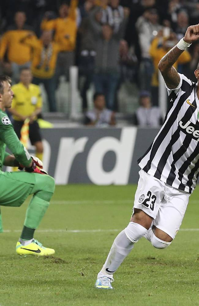 Juventus Chilean midfielder Arturo Vidal, right, celebrates past Galatasaray Uruguayan goalkeeper Fernando Muslera after scoring, during a Champions League, Group B, soccer match between Juventus and Galatasaray at the Juventus stadium in Turin, Italy, Wednesday, Oct. 2, 2013