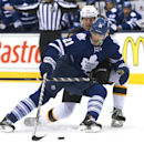Toronto Maple Leafs forward James van Riemsdyk (21) guards the puck against Boston Bruins defenseman Zach Trotman (62) during the second period of an NHL hockey game Wednesday, Nov. 12, 2014, in Toronto The Associated Press