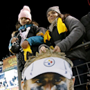 Pittsburgh Steelers fans hold a poster of Steelers defensive end Brett Keisel as the teams warm up before an NFL football game against the Baltimore Ravens, Sunday, Nov. 2, 2014, in Pittsburgh The Associated Press