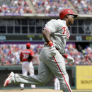 Philadelphia Phillies' Marlon Byrd rounds the bases after hitting a home run off Texas Rangers relief pitcher Pedro Figueroa during the sixth inning of an opening day baseball game at Globe Life Park, Monday, March 31, 2014, in Arlington, Texas The Associ