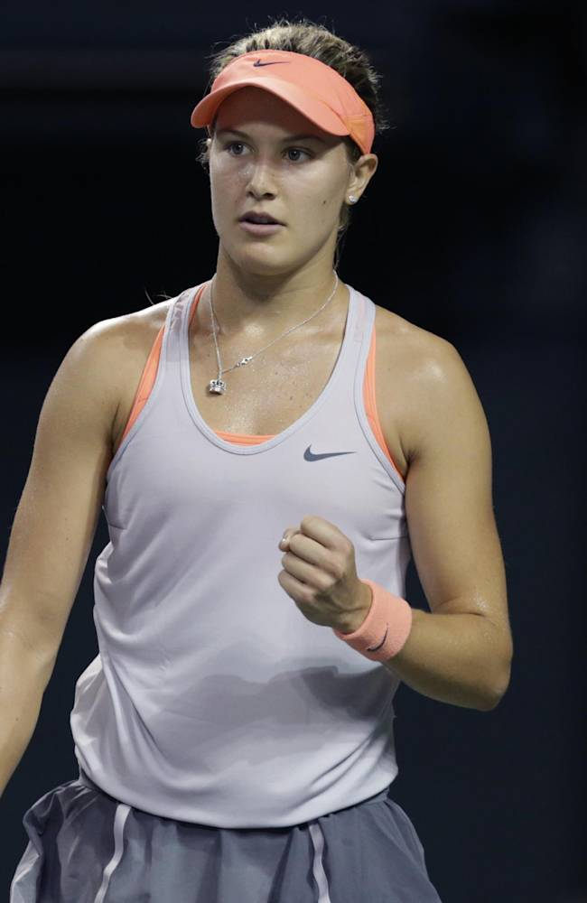 Eugenie Bouchard of Canada reacts after getting a point against Serbia's Jelena Jankovic during their third round match of the Pan Pacific Open tennis tournament in Tokyo, Wednesday, Sept. 25, 2013