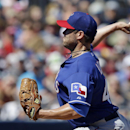 Texas Rangers starting pitcher Colby Lewis throws during the first inning of an exhibition spring training baseball game against the Seattle Mariners, Sunday, March 9, 2014, in Peoria, Ariz The Associated Press