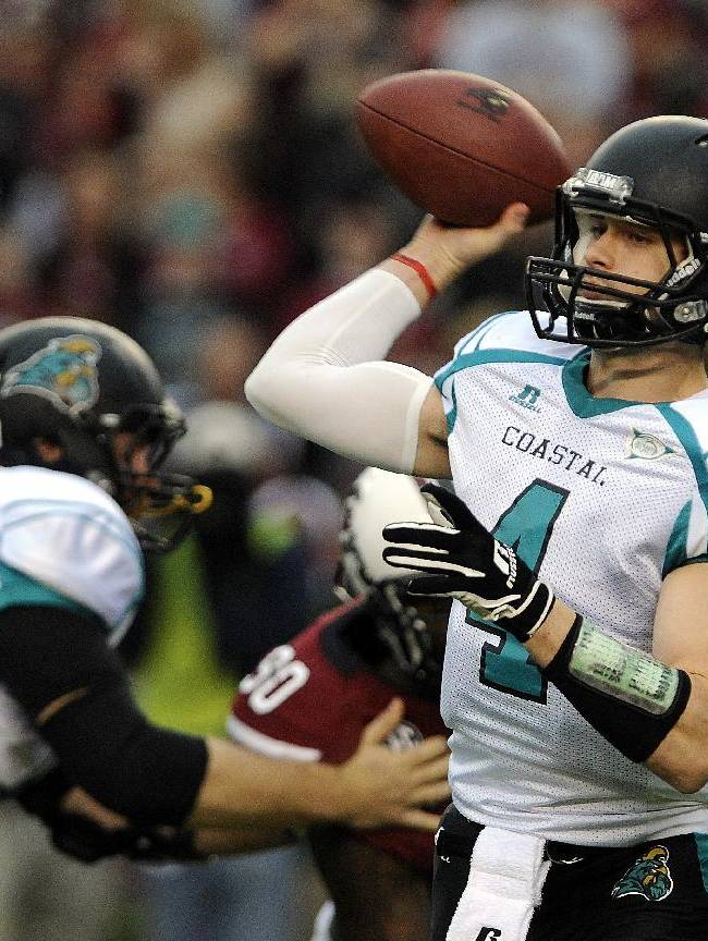 Coastal Carolina quarterback Alex Ross (4) passes down field during the first half of an NCAA college football game against South Carolina, Saturday, Nov. 23, 2013 in Columbia, S.C