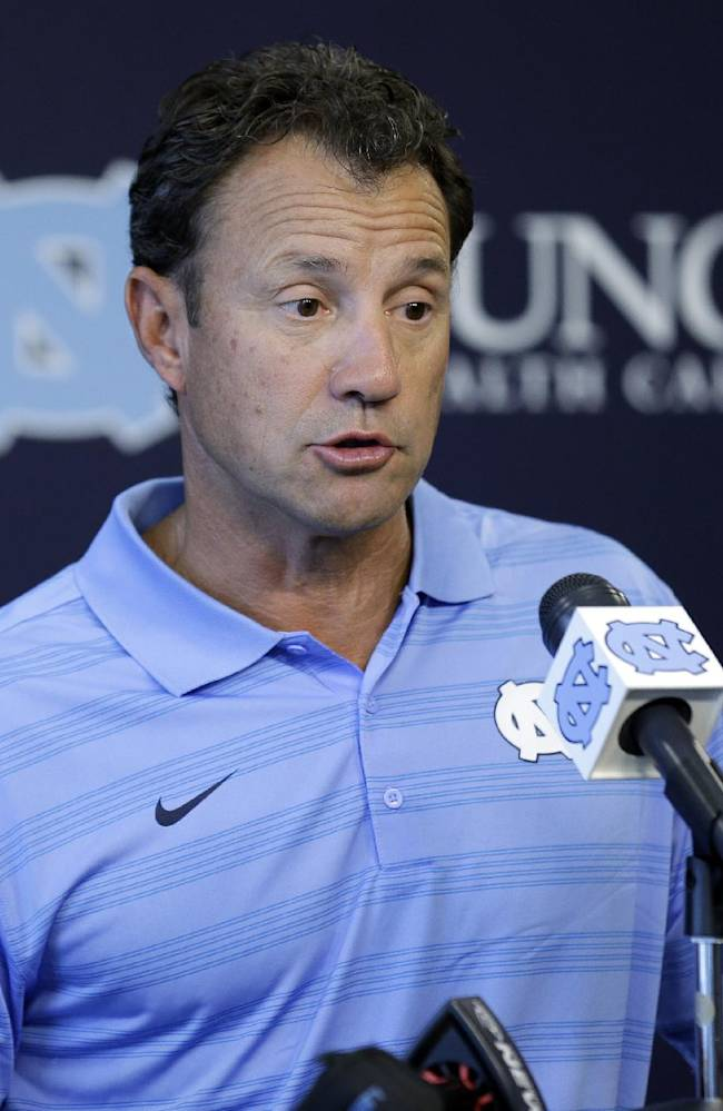 North Carolina coach Larry Fedora makes comments during an NCAA football media day in Chapel Hill, N.C., Saturday, Aug. 2, 2014