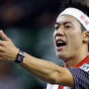 Kei Nishikori of Japan reacts after losing a point against Ivan Dodig of Croatia during their first round match of Japan Open Tennis Championships in Tokyo, Wednesday, Oct. 1, 2014. (AP Photo/Shizuo Kambayashi)