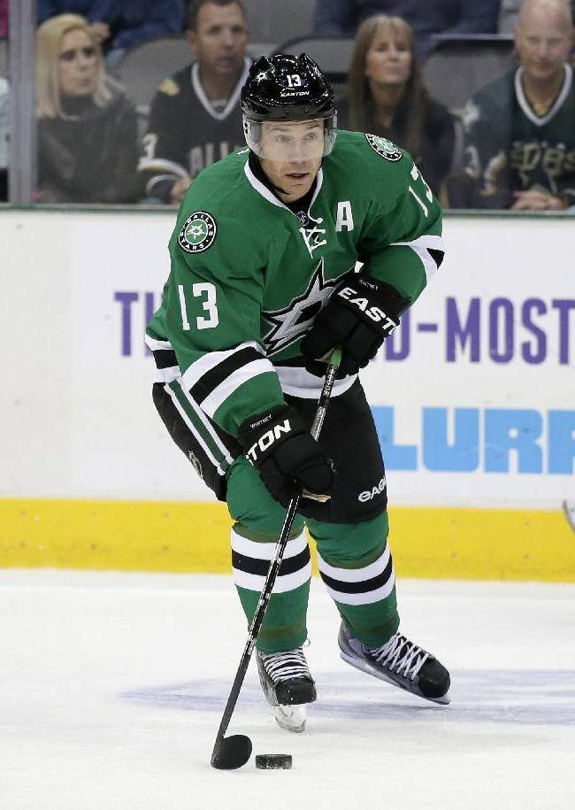 Dallas Stars' Ray Whitney (13) handles the puck in the first period of an NHL hockey game against the Calgary Flames, Saturday, Oct. 26, 2013, in Dallas. The Jets won in a shootout, 2-1