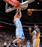 LOS ANGELES, CA - JANUARY 5: Timofey Mozgov #25 of the Denver Nuggets dunks during a game against the Los Angeles Lakers at STAPLES Center on January 5, 2014 in Los Angeles, California. (Photo by Andrew D. Bernstein/NBAE via Getty Images)