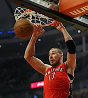 CHICAGO, IL - DECEMBER 14: Jonas Valanciunas #17 of the Toronto Raptors dunks against the Chicago Bulls at the United Center on December 14, 2013 in Chicago, Illinois. (Photo by Jonathan Daniel/Getty Images)