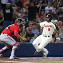 Atlanta Braves' Justin Upton (8) scores a run past Washington Nationals catcher Sandy Leon in the fifth inning of a baseball game on Saturday, April 12, 2014, in Atlanta The Associated Press