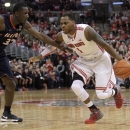 Ohio State's Deshaun Thomas, right, drives to the basket against Illinois' Nnanna Egwu during the second half of an NCAA college basketball game Sunday, March 10, 2013, in Columbus, Ohio. Ohio State defeated Illinois 68-55. (AP Photo/Jay LaPrete)
