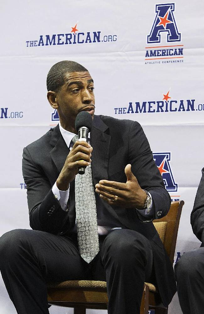 Connecticut coach Kevin Ollie answers questions at the American Athletic Conference NCAA college basketball media day on Wednesday, Oct. 16, 2013 in Memphis, Tenn