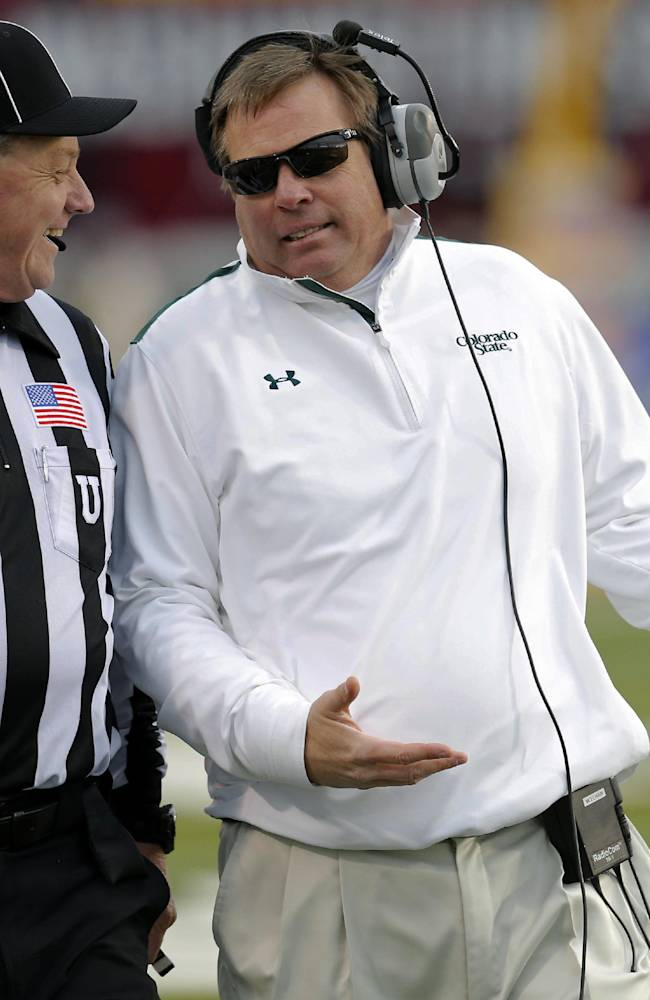 Colorado State head coach Jim McElwain talks with referee Ken Williamson during the second half of the NCAA New Mexico Bowl college football game against Washington State, Saturday, Dec. 21, 2013, in Albuquerque, N.M. Colorado State won 48-45