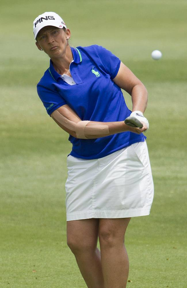 Angela Stanford chips onto the fifth green in the final round of the LPGA LOTTE Championship golf tournament at Ko Olina Golf Club, Saturday, April 19, 2014, in Kapolei, Hawaii