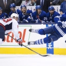 Toronto Maple Leafs forward Richard Panik, right, gets hit by Washington Capitals forward Jay Beagle, left, during the second period of an NHL hockey game, Wednesday, Jan. 7, 2015 in Toronto The Associated Press