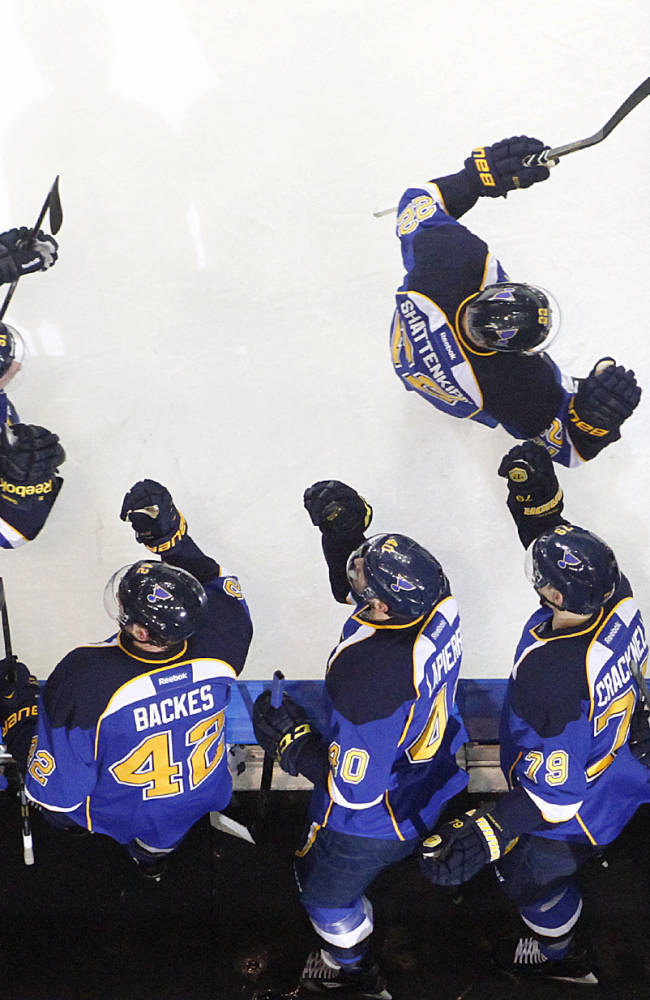 St. Louis Blues defenseman Kevin Shattenkirk, top right, celebrates with teammates on the bench after scoring in the first period during Game 2 of a first-round NHL hockey playoff series against the Chicago Blackhawks, Saturday, April 19, 2014, in St. Louis. Blues right wing Vladimir Tarasenko, top left, assisted on the goal and later scored a goal in the third period