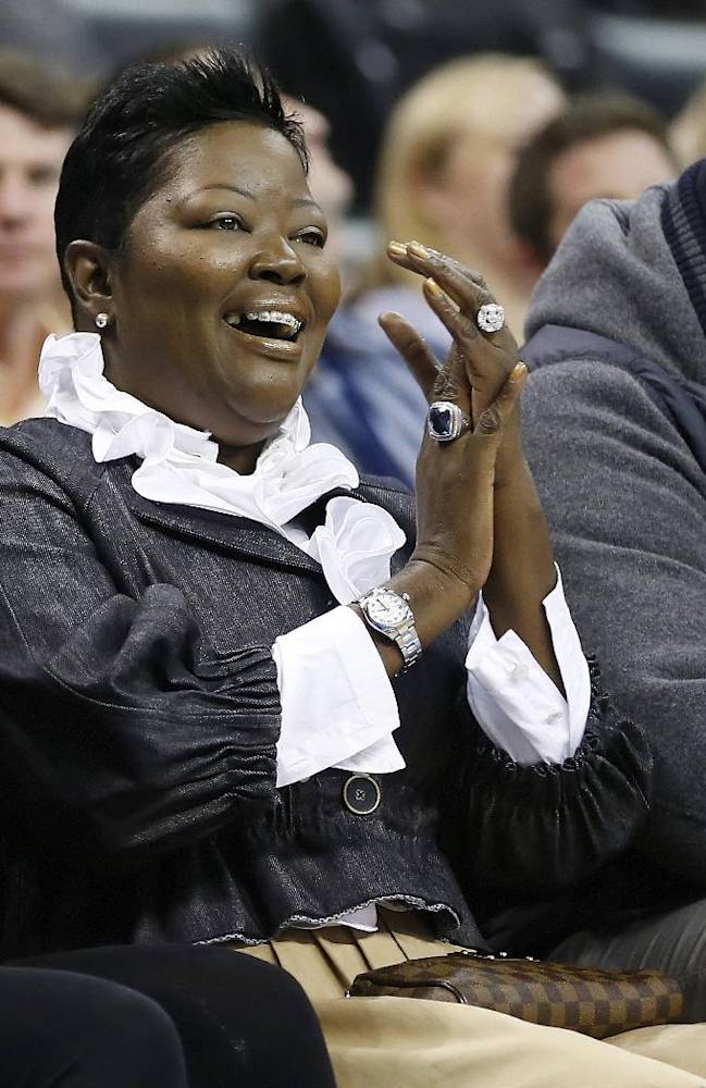 Wanda Pratt, center, Kevin Durant's mother, applauds as she sits between Tony Durant, right, Kevin's brother, and Kevin's fiancee, Monica Wright, left, during the second quarter of a preseason NBA basketball game as the Oklahoma City Thunder faced the Denver Nuggets in Oklahoma City, Tuesday, Oct. 15, 2013