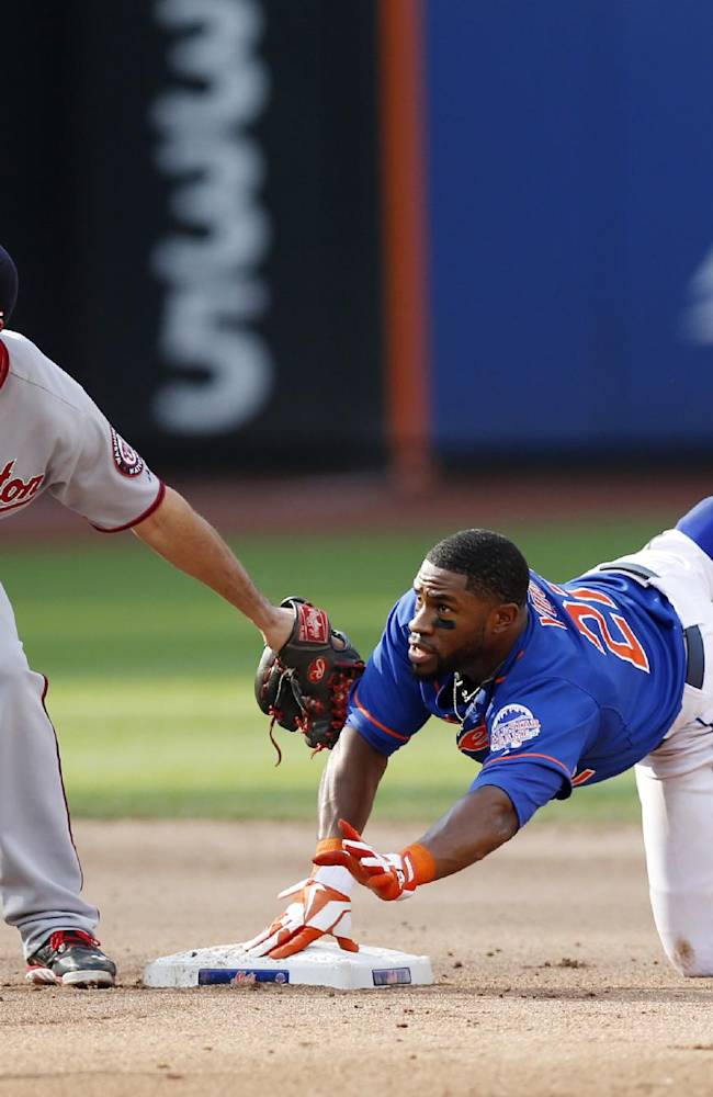 Washington Nationals second baseman Anthony Rendon, left, and New York Mets' Eric Young, right, look for the umpire's call after Young stole second in the seventh inning of a baseball game on Thursday, Sept. 12, 2013, in New York. The Nationals won 7-2