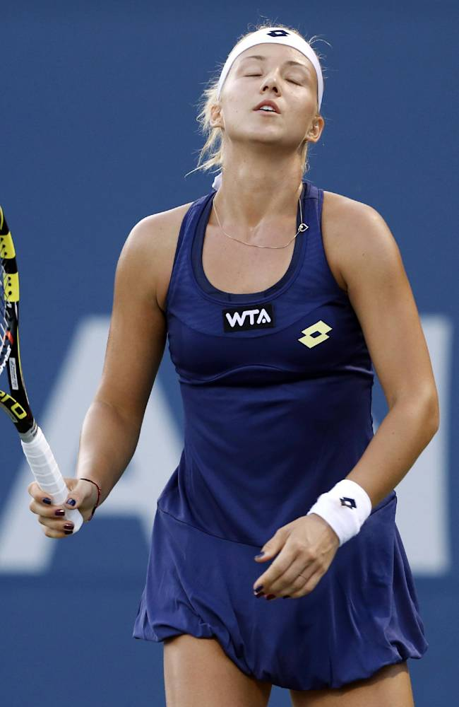 Paula Kania reacts reacts after giving up a point during the second set of her match against Venus Williams in the Bank of the West Classic, Tuesday, July 29, 2014, in Stanford, Calif