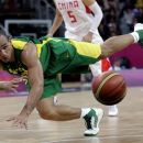 Brazil's Alex Garcia dives for a loose ball during a preliminary men's basketball game against China at the 2012 Summer Olympics, Saturday, Aug. 4, 2012, in London. (AP Photo/Eric Gay)