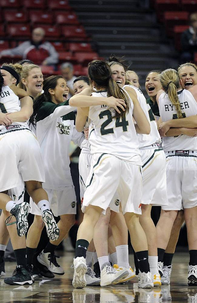 Colorado State celebrates after defeating Utah State in an NCAA college basketball game in the Mountain West Conference women's tournament on Tuesday, March 11, 2014, in Las Vegas. Colorado State won 72-67