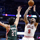 Chicago Bulls forward Carlos Boozer, right, shoots over Milwaukee Bucks center Zaza Pachulia during the first half of an NBA basketball game in Chicago, Friday, April 4, 2014 The Associated Press