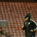 Real Madrid's coach Carlo Ancelotti crosses the pitch as his team train at Anfield Stadium, in Liverpool, England, Tuesday, Oct. 21, 2014. Real Madrid will play Liverpool in a Champion's League Group B soccer match on Wednesday