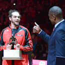 Chicago Bulls center Joakim Noah (13) gets a thumbs up from Dikembe Motumbo after receiving the Defensive Player of the Year award before Game 2 in an opening-round NBA basketball playoff series Tuesday, April 22, 2014, in Chicago. The Wizards won 101-99