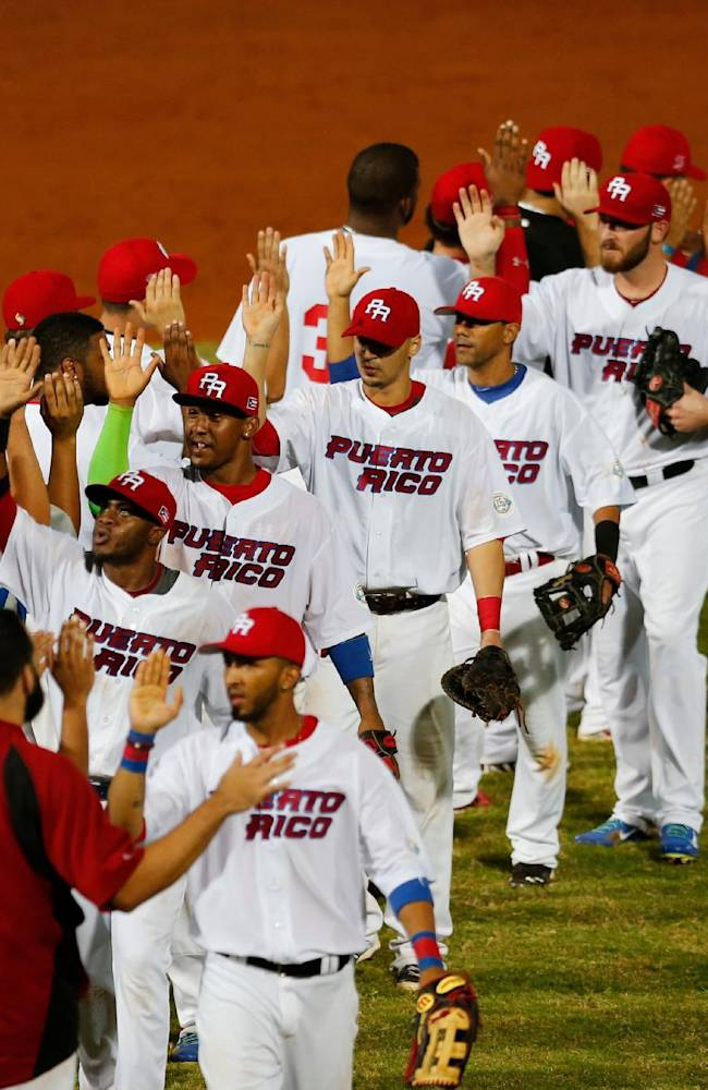 Puerto Rico's players celebrate after defeatingVenezuela 5-4 in a Caribbean Series baseball game in Porlamar, Venezuela, Thursday, Feb. 6, 2014