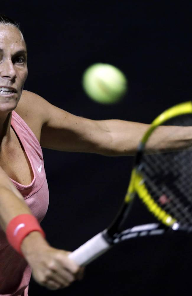 Roberta Vinci of Italy returns the ball against Lucie Safarova of the Czech Republic during their second round match of Pan Pacific Open tennis tournament in Tokyo, Monday, Sept. 23, 2013