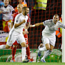 Real Madrid's Karim Benzema, left, celebrates after scoring his side's third goal during the Champions League group B soccer match between Liverpool and Real Madrid at Anfield Stadium, Liverpool, England, Wednesday Oct. 22, 2014