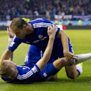 Chelsea's Andre Schurrle, bottom, celebrates with teammate Branislav Ivanovic after scoring against Burnley during their English Premier League soccer match at Turf Moor Stadium, Burnley, England, Monday Aug. 18, 2014