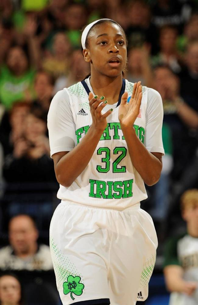 Notre Dame guard Jewell Loyd applauds her team's effort during a time out in the first half of their NCAA women's college basketball tournament regional final game at the Purcell Pavilion in South Bend, Ind Monday March 31, 2014