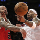 Chicago Bulls forward Carlos Boozer (5) tugs at the jersey of New York Knicks forward Kenyon Martin in the first half of their NBA basketball game at Madison Square Garden in New York, Wednesday, Dec. 11, 2013 The Associated Press