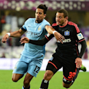 Manchester City's Scott Sinclair, left, fights for the ball with Hamburg's Goetz Ashton during a friendly soccer match in Al Ain, United Arab Emirates, Wednesday, Jan. 21, 2015