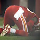 In this Sept. 29, 2014, photo, Kansas City Chiefs free safety Husain Abdullah prays after intercepting a pass and running it back for a touchdown during the fourth quarter of an NFL football game against the New England Patriots Monday, Sept. 29, 2014, in