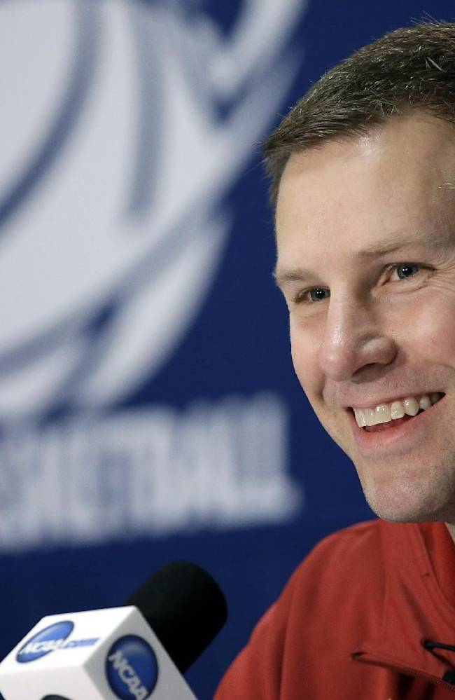 In this March 22, 2014 file photo, Iowa State coach Fred Hoiberg smiles as he answers a question during an NCAA college basketball tournament news conference in San Antonio. Iowa State has given Hoiberg a $600,000 a year raise, bumping his average annual salary to $2.6 million in an effort to keep