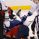 Vancouver Canucks' Christopher Tanev (8) falls over Florida Panthers' Brad Boyes (24) during the second period of an NHL hockey game in Sunrise, Fla., Monday, Jan. 19, 2015 The Associated Press