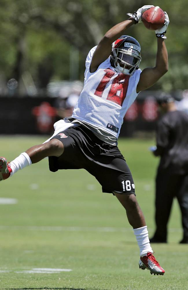 Tampa Bay Buccaneers wide receiver Skye Dawson makes a leaping catch during a voluntary minicamp NFL football practice Wednesday, April 23, 2014, in Tampa, Fla