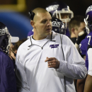 Mount Union coach Vince Kehres gather with his player during the second half against Wisconsin-Whitewater in the NCAA Division III championship college football game at Salem Stadium in Salem, Va., Friday Dec. 19, 2014. Whitewater won 43-34 The Associate