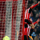 Sunderland's Connor Wickham, right, celebrates his goal with Steven Fletcher, left, during their English Premier League soccer match against Manchester City at the Stadium of Light, Sunderland, England, Wednesday, Dec. 3, 2014
